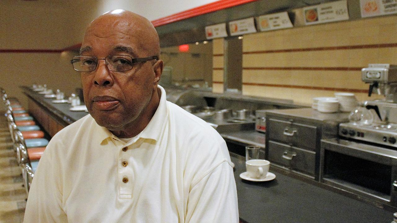 Clarence Henderson sits at the Woolworths lunch counter in Greensboro, NC, on Sept. 16, 2016