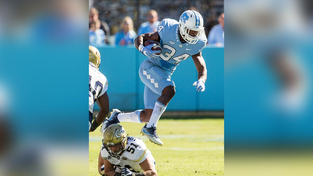 North Carolinas Elijah Hood (34) jumps over Georgia Techs Brant Mitchell (51) during the first half of an NCAA college football game Chapel Hill, N.C., Saturday, Nov. 5, 2016.