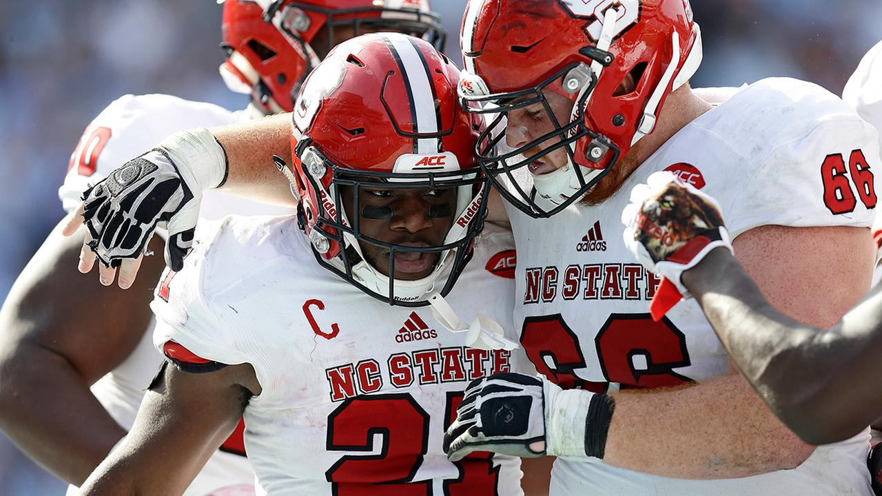 Wolfpack senior Matthew Dayes led the way with 106 yards rushing and two touchdowns to ruin the Tar Heels senior day.Gerry Broome