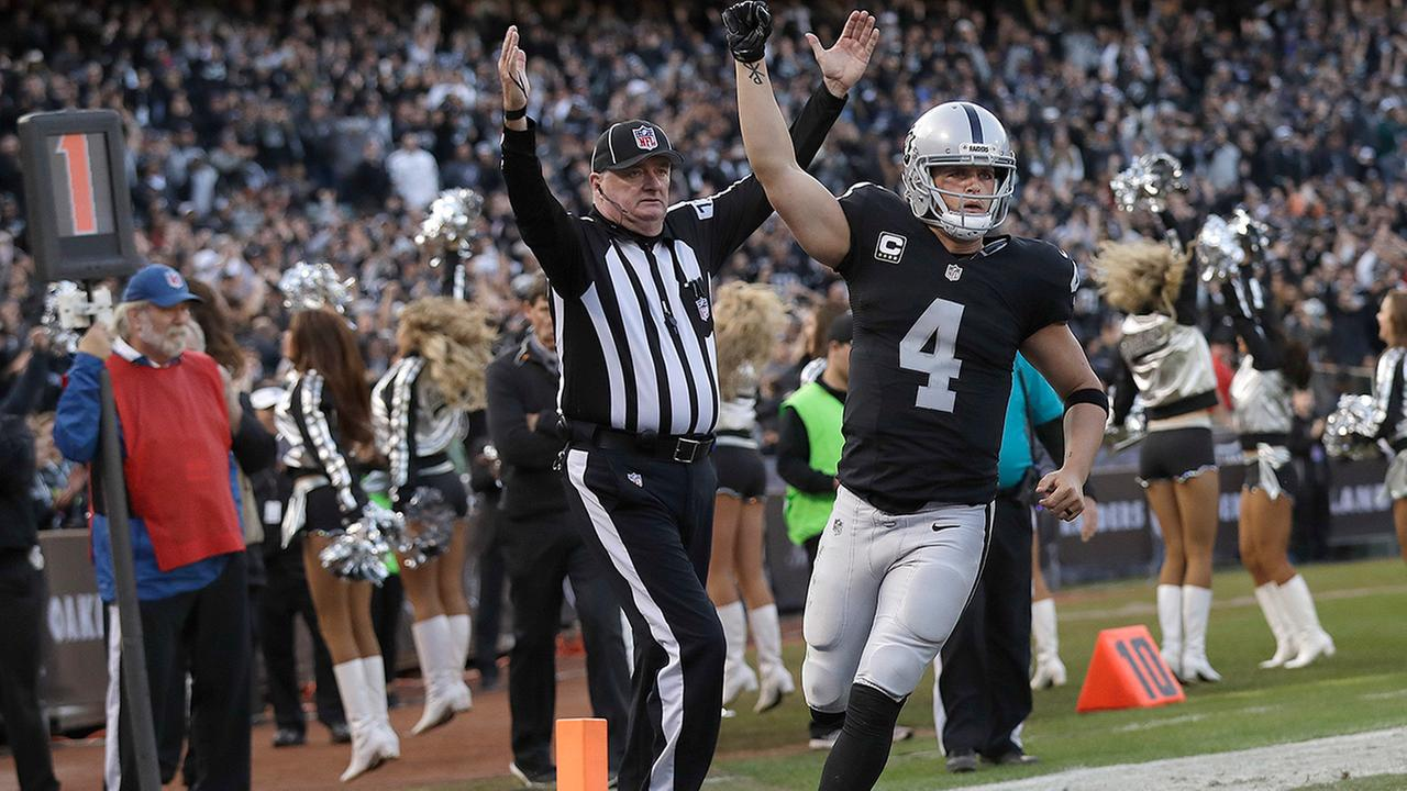 Oakland Raiders quarterback Derek Carr (4) celebrates after throwing for two-point point after try against the Carolina Panthers during the second half of an NFL football game in Oakland, Calif., Sunday, Nov. 27, 2016.
