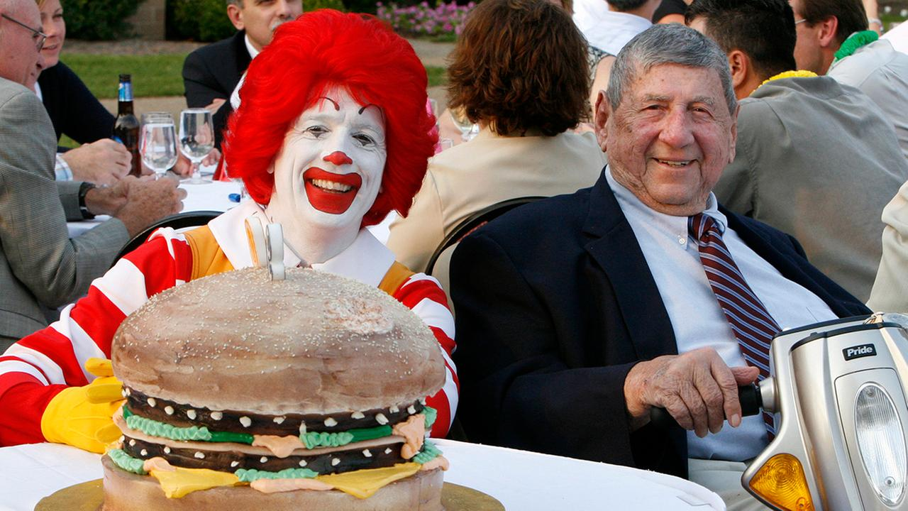 In this Aug. 21, 2008 file photo Big Mac creator Jim Delligatti, right, poses with a Big Mac birthday cake and Ronald McDonald at his 90th birthday party in Canonsburg, Pa.