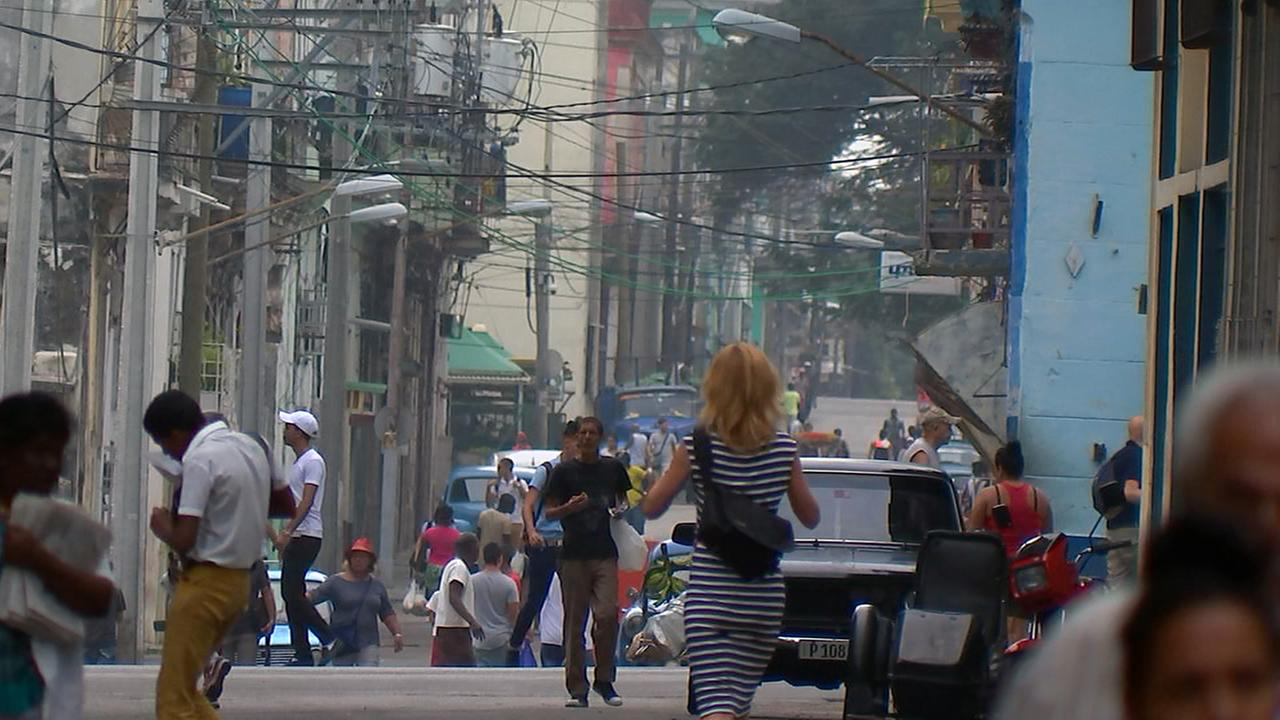 A long view of a city street in Havana.Adolfo Ibarra