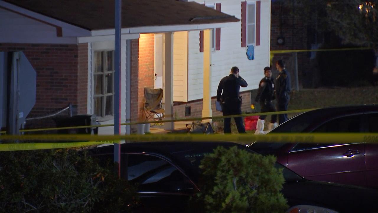 Authorities inspect the scene of a fatal officer-involved shooting in Fayetteville
