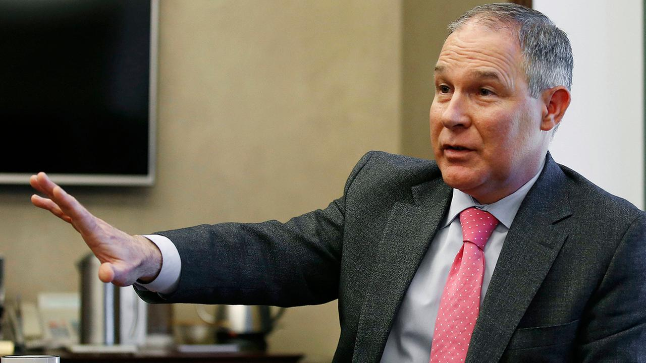 In this Thursday, March 10, 2016 photo, Scott Pruitt, Oklahoma Attorney General, gestures as he speaks during an interview in Oklahoma City.