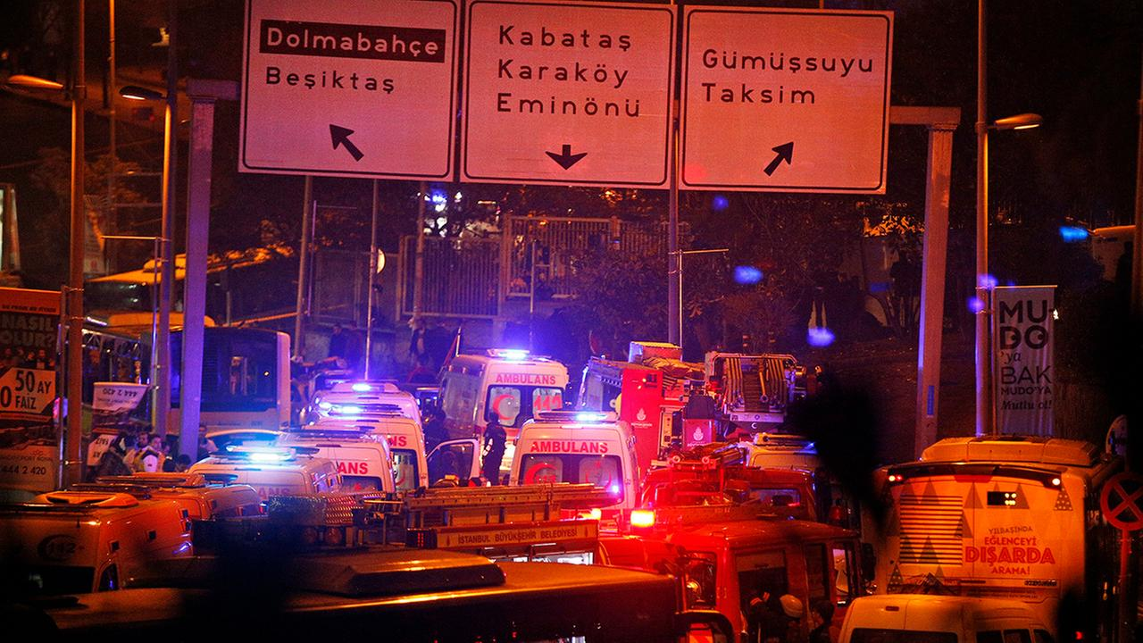 Rescue services rush to the scene of explosions near the Besiktas football club stadium, following at attack in Istanbul, late Saturday, Dec. 10, 2016.