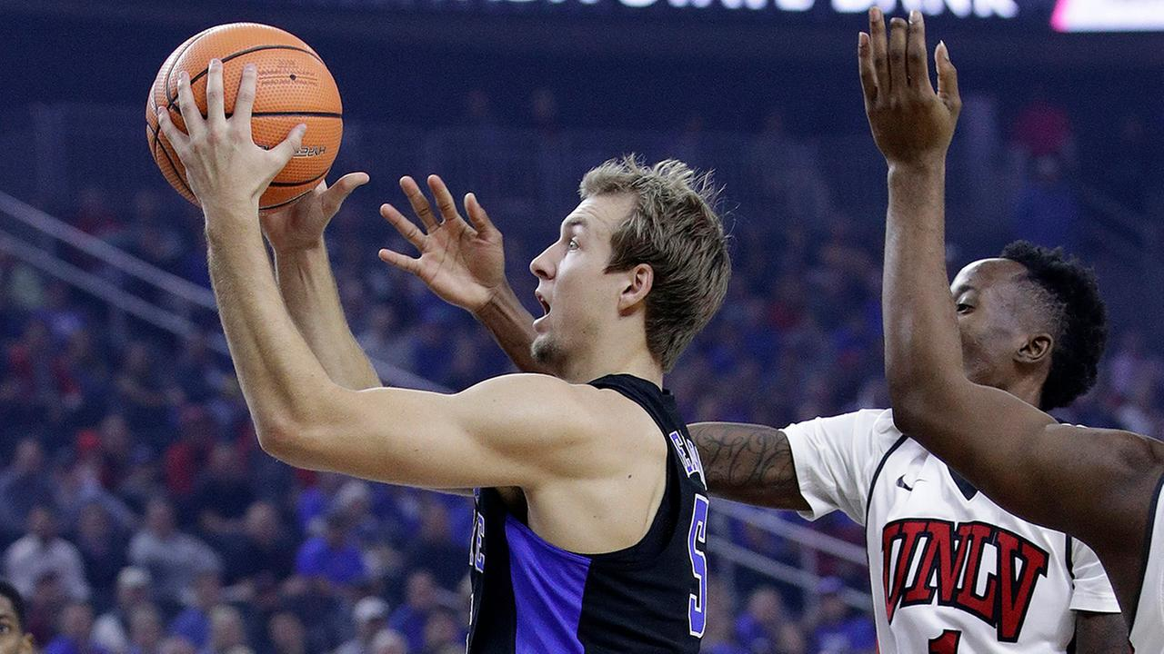 Duke guard Luke Kennard shoots against UNLV guard Kris Clyburn during the first half of an NCAA college basketball game Saturday, Dec. 10, 2016, in Las Vegas.