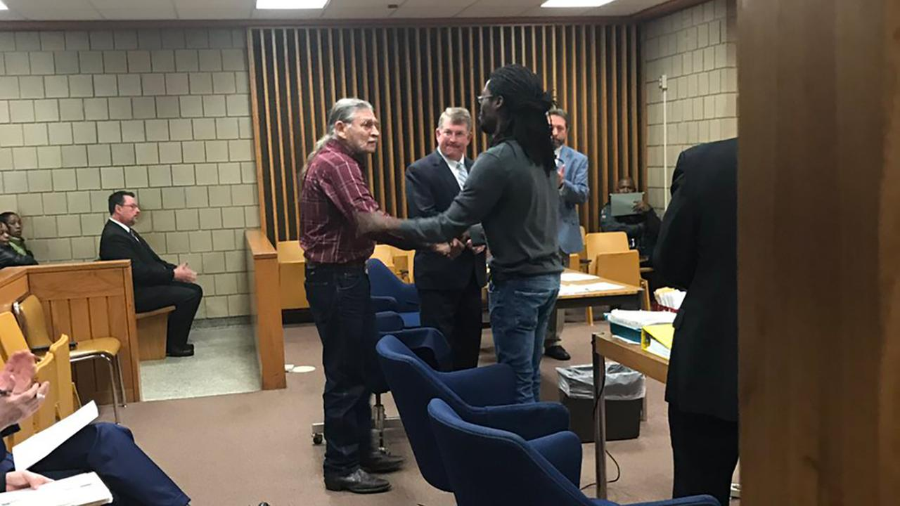 John McGraw and Rakeem Jones shake hands in a Fayetteville courtroom