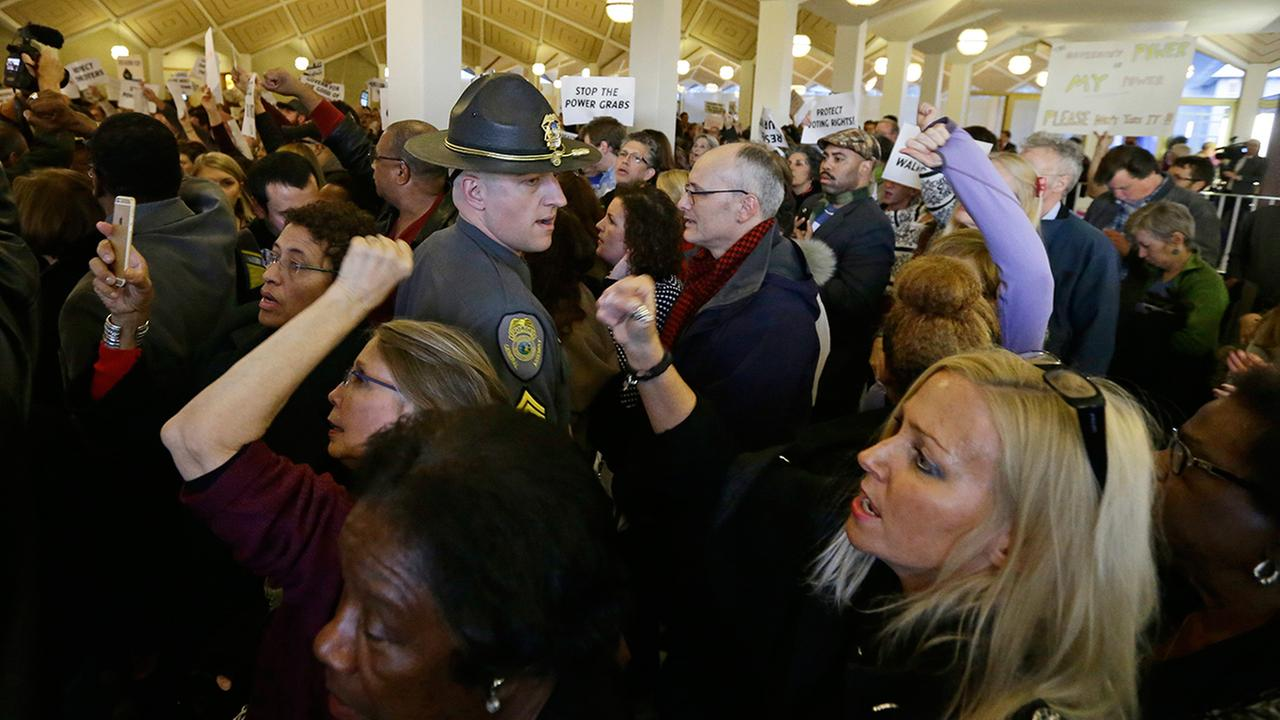 Demonstrators crowd the rotunda outside the House and Senate galleries during a special session at the North Carolina Legislature in Raleigh, N.C., Thursday, Dec. 15, 2016.AP Photo/Gerry Broome
