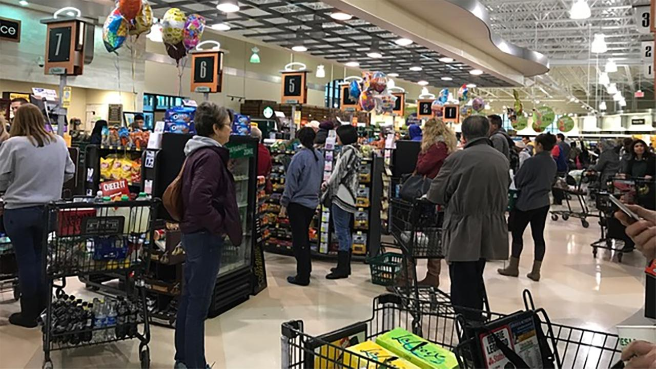 Long lines Friday afternoon at Harris Teeter on Ninth Street near downtown Durham.Andrea Epps