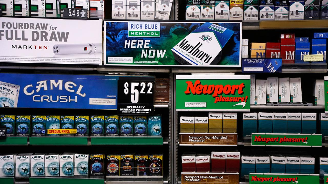 Camel and Newport cigarettes, both Reynolds American brands, are on display.