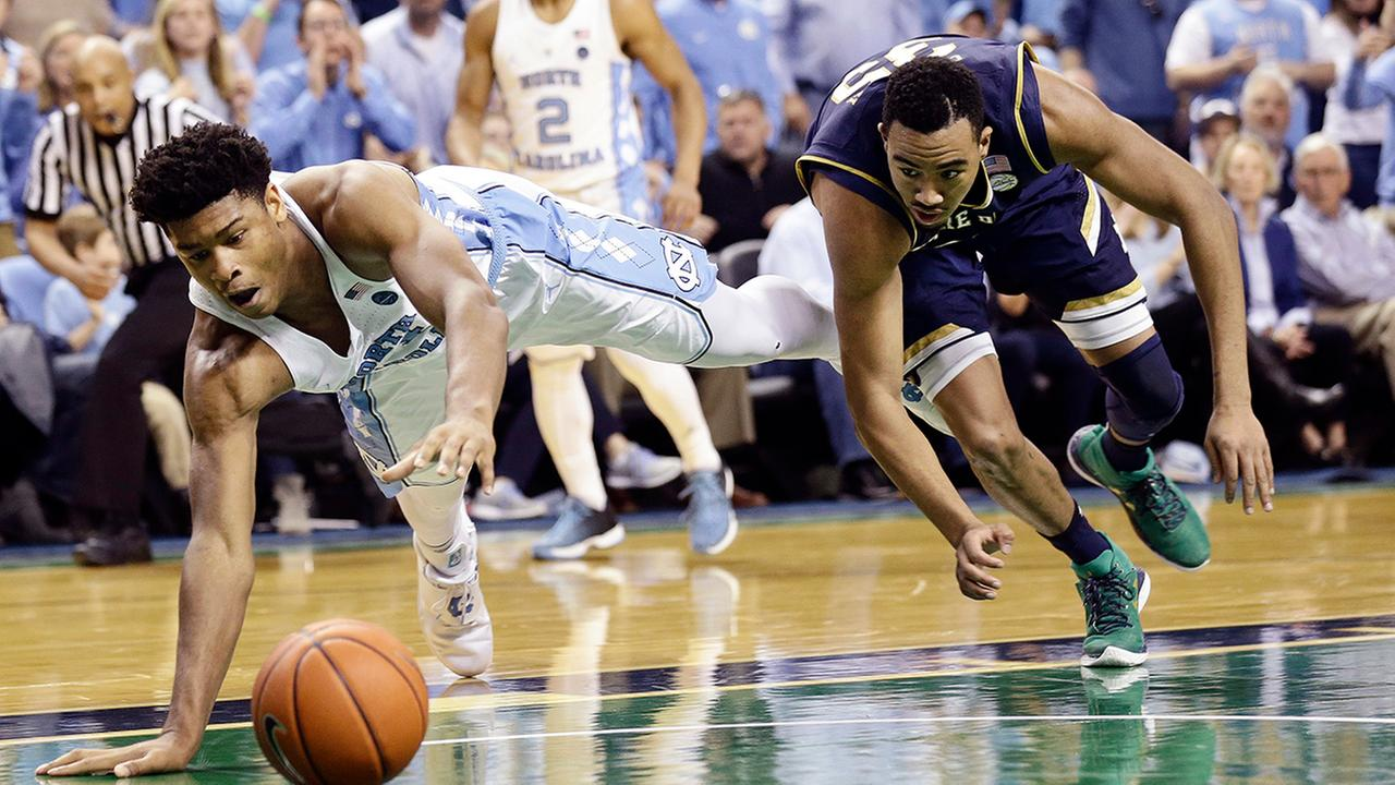 North Carolinas Isaiah Hicks, left, and Notre Dames Bonzie Colson chase the ball during the second half of an NCAA college basketball game in Greensboro, N.C., Sunday, Feb. 5, 2017.
