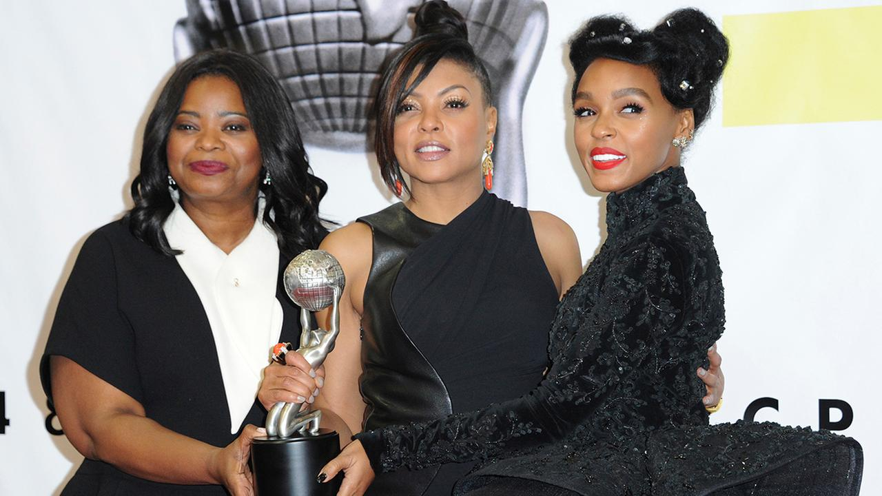 Octavia Spencer, from left, Taraji P. Henson and Janelle Monae pose with the award for outstanding motion picture for Hidden Figures at the 48th annual NAACP Image Awards