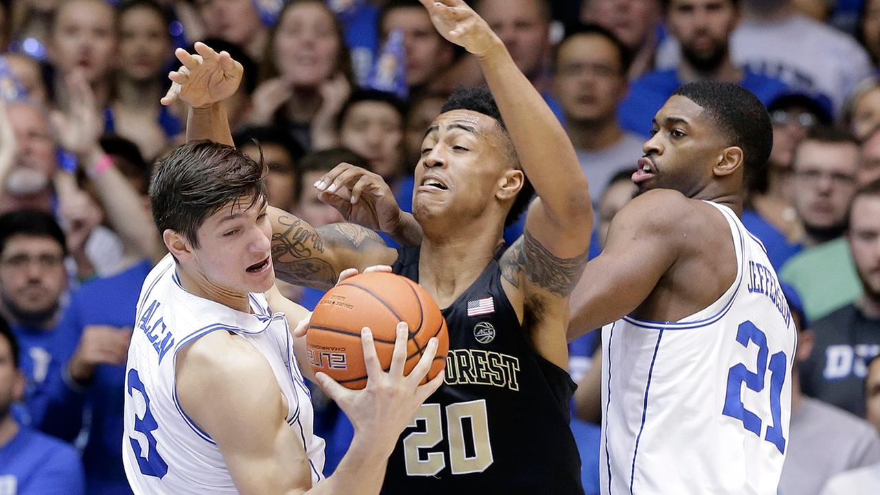 Dukes Grayson Allen (3) and Amile Jefferson (21) struggle for the ball with Wake Forests John Collins (20) during the second half of an NCAA college basketball game in Durham