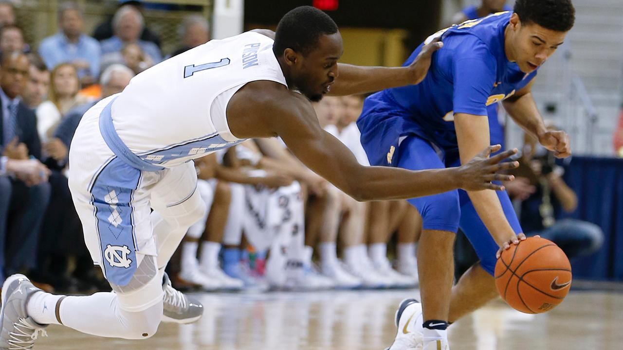 North Carolinas Theo Pinson, left, and Pittsburghs Cameron Johnson (23) chase after a loose ball during the first half of an NCAA college basketball game, Saturday, Feb. 25, 2017, in Pittsburgh.