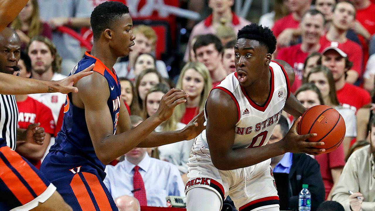 North Carolina State s Abdul-Malik Abu (0) tries to move the ball agains Virginias Mamadi Diakite (25) during the second half of an NCAA college basketball game in Raleigh, N.C., Saturday, Feb. 25, 2017.