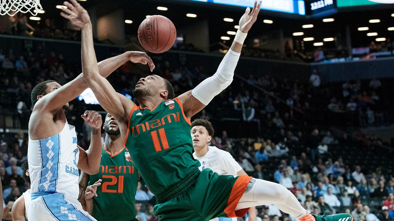 North Carolina forward Kennedy Meeks, left, stops Miami guard Bruce Brown (11) from scoring during the first half of an NCAA college basketball game in the Atlantic Coast Conference tournament, Thursday, March 9, 2017, in New York.