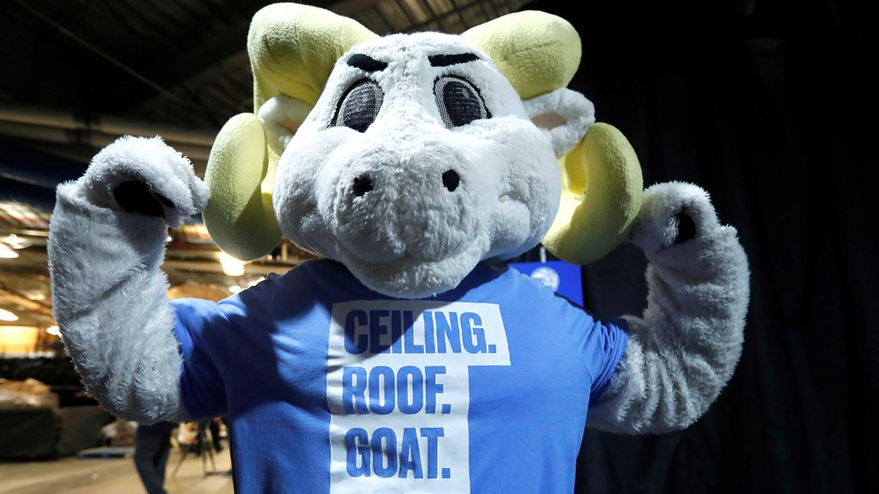 UNC's marching band is wearing 'The Ceiling is the Roof' themed t-shirts
