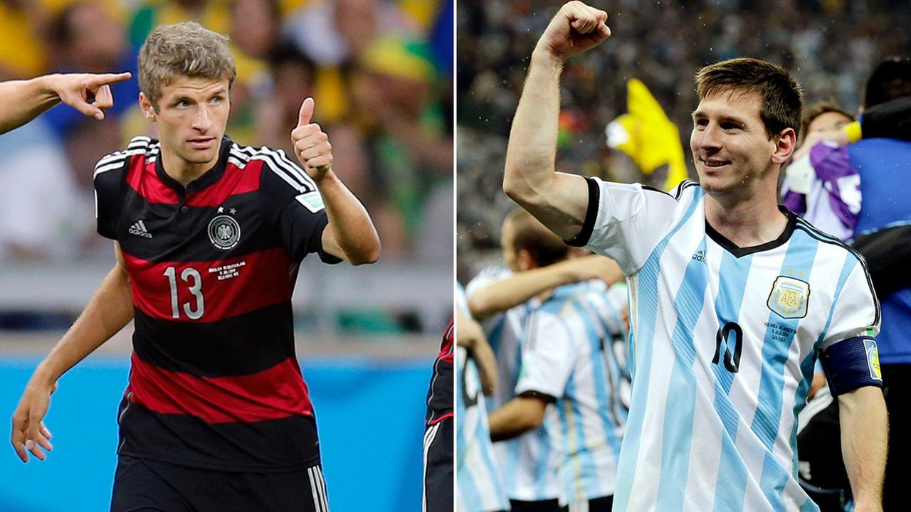 (L-R): Thomas Muller of Germany, Lionel Messi of Argentina