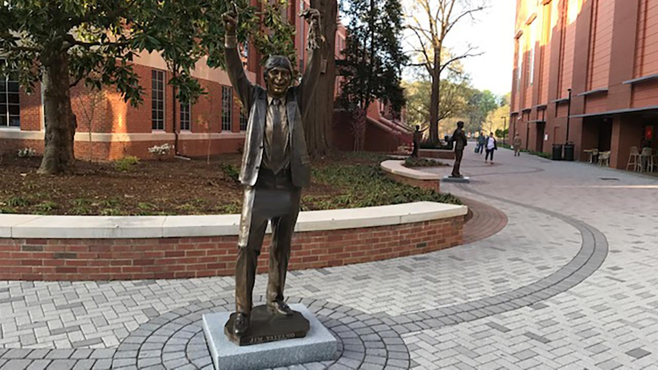 Someone spray painted the statue of Jim Valvano, which sits in front of Reynolds Coliseum on N.C. State Universitys campus