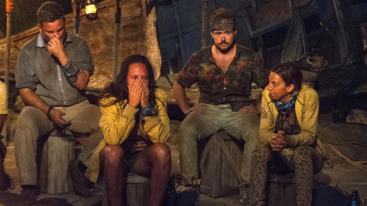 In this image released by CBS, contestants, from left, Jeff Varner, Sarah Lacina, Zeke Smith and Debbie Wanner appear at the Tribal Council portion of the competition series Survivor: Game Changers.
