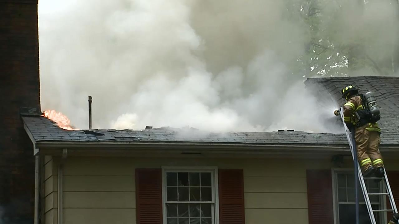 The flames burned through the roof of the 2-story house