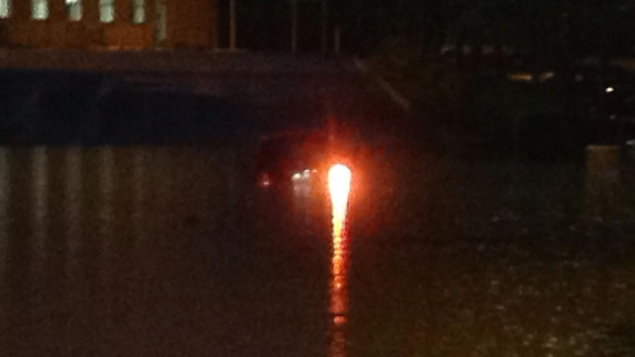 A car submerged in high water in Raleigh