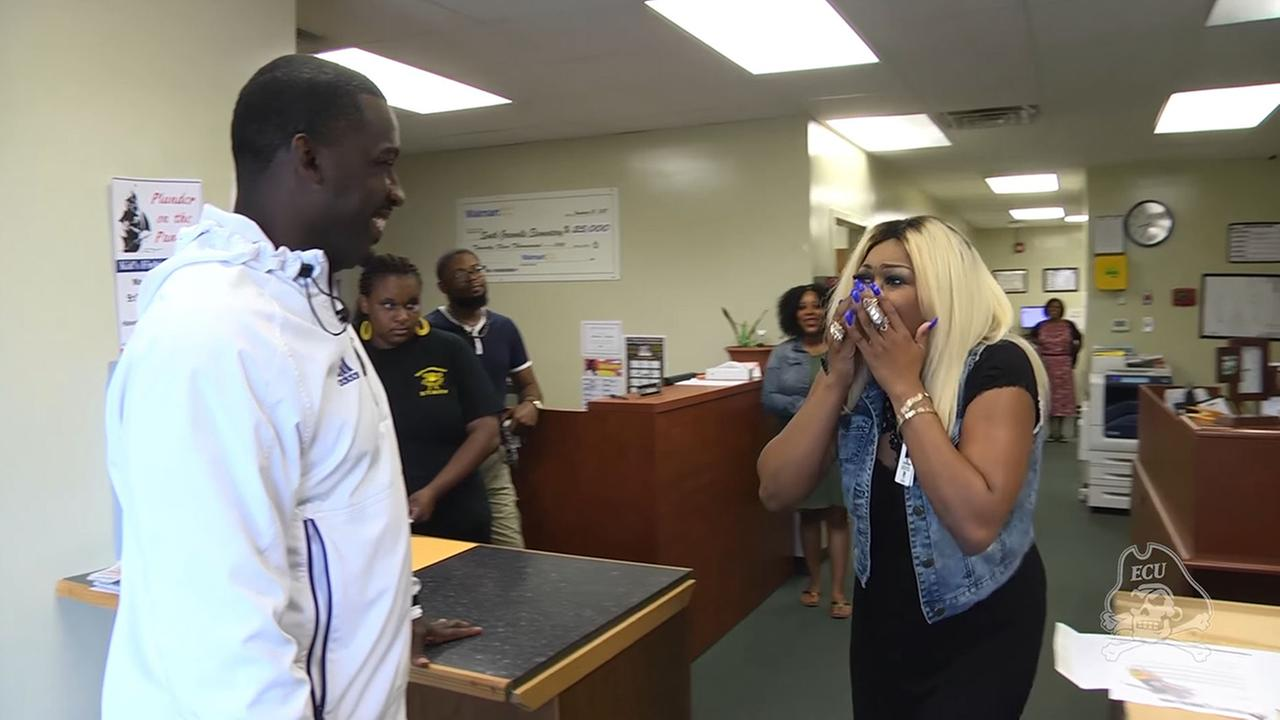 ECU football coach surprises player's mom with full scholarship