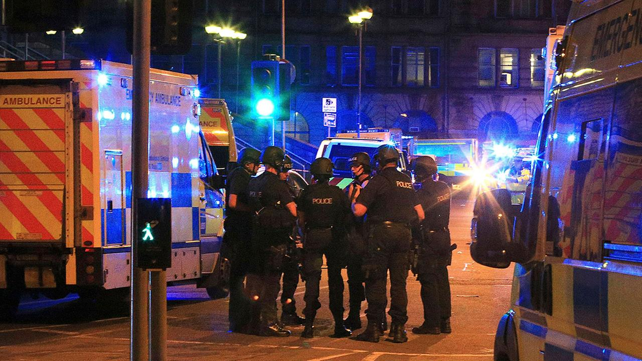 Armed police gather at Manchester Arena after reports of an explosion at the venue during an Ariana Grande gig in Manchester, England