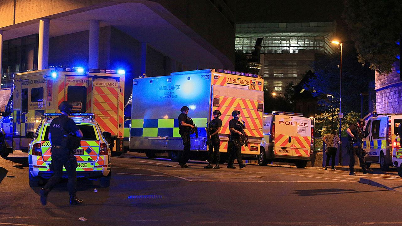 Police respond at Manchester Arena after reports of an explosion at the venue during an Ariana Grande gig in Manchester, England