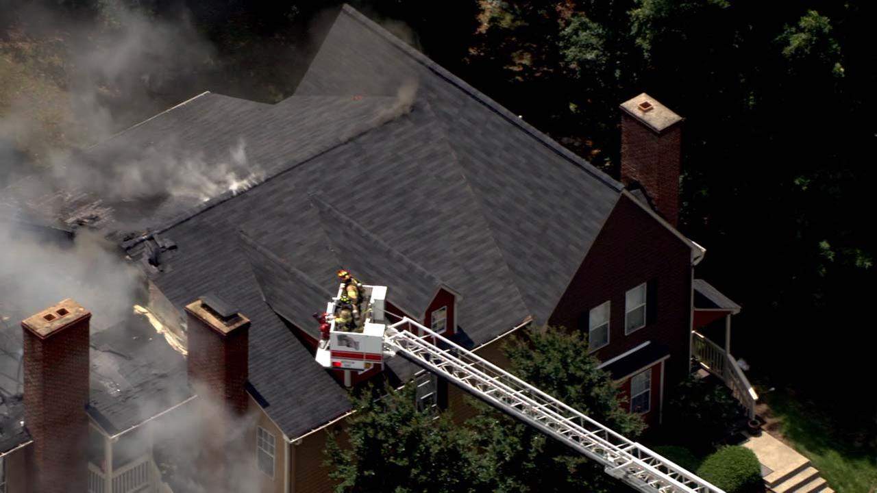 Raleigh firefighters battle a blaze in a townhome complex