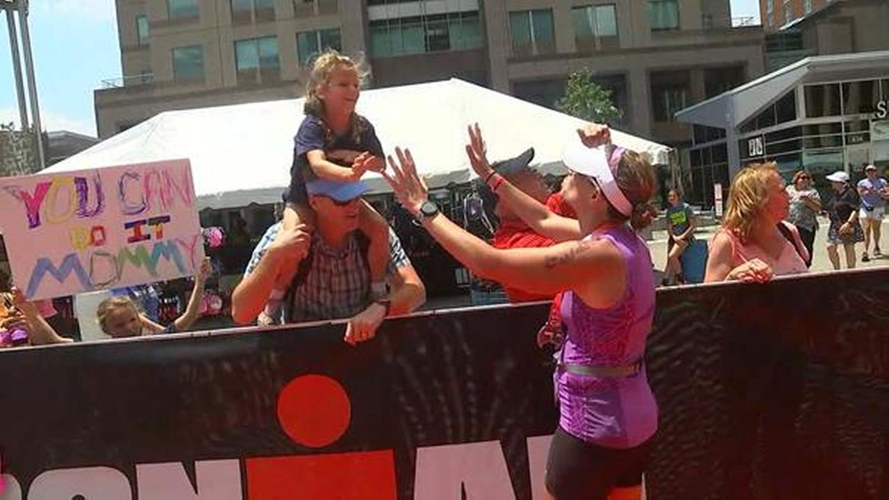 Diane Wilson crossing the Raleigh Half Ironman finish line.