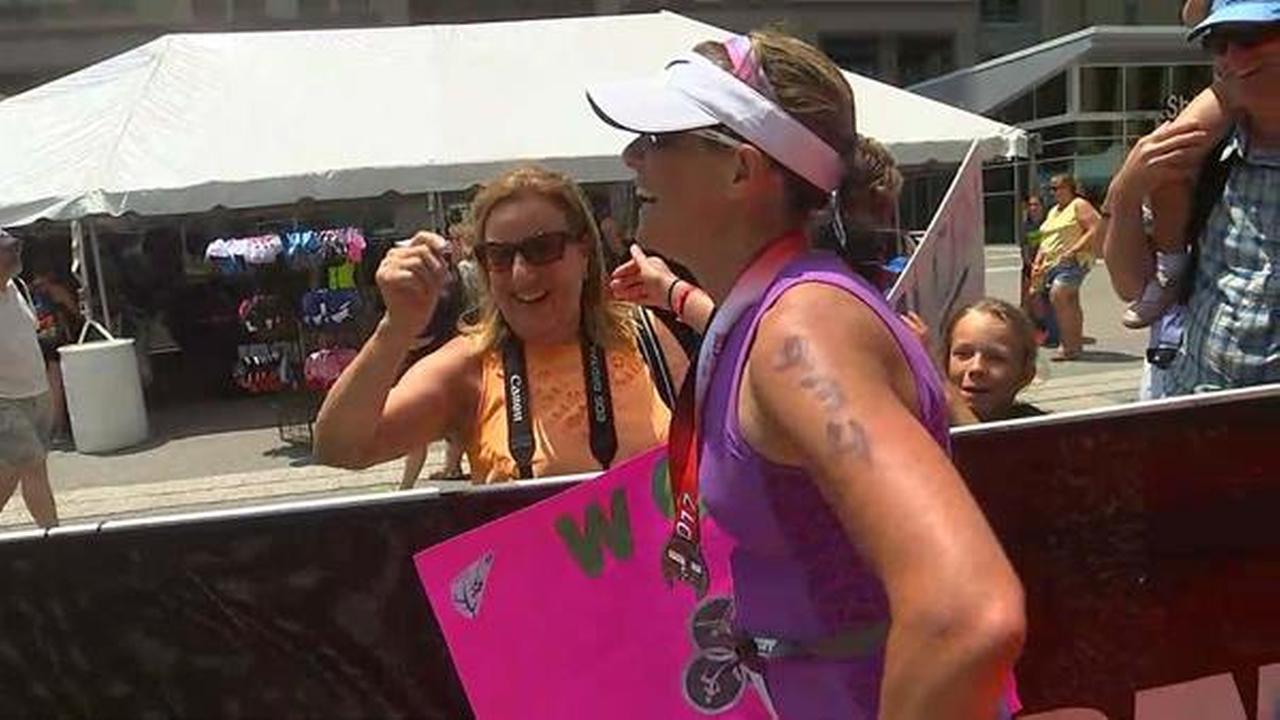 Diane Wilson crossing the Raleigh Half Ironman finish line.