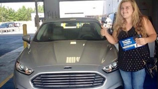 Allison Cope pictured with he car