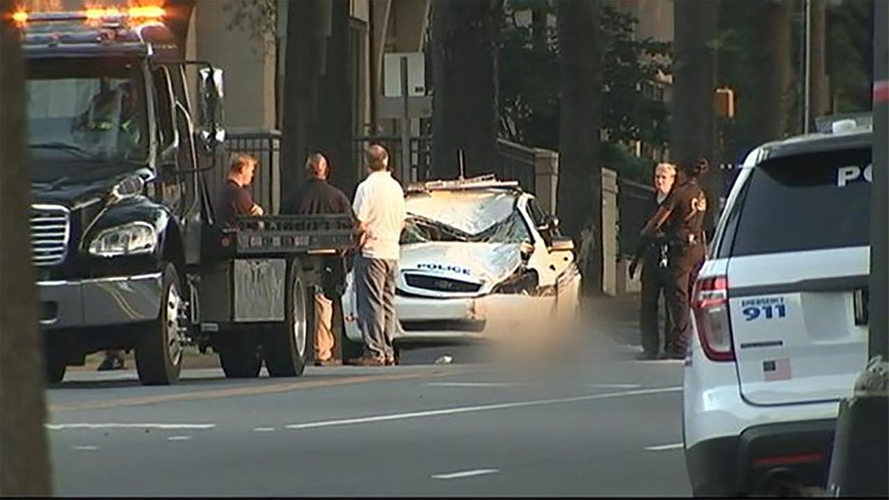 Charlotte Police investigate the death of a pedestrian who was hit by a police car.