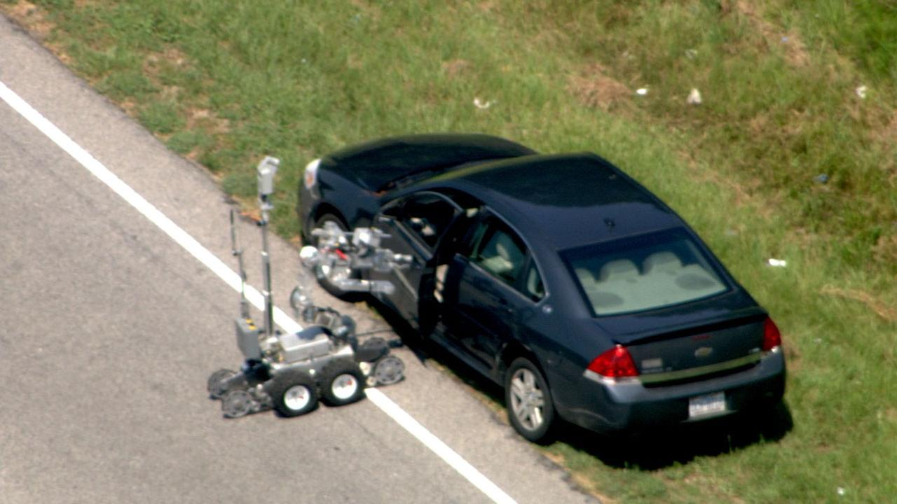 Images from Chopper 11 HD showed a bomb squad robot checking out the vehicle.