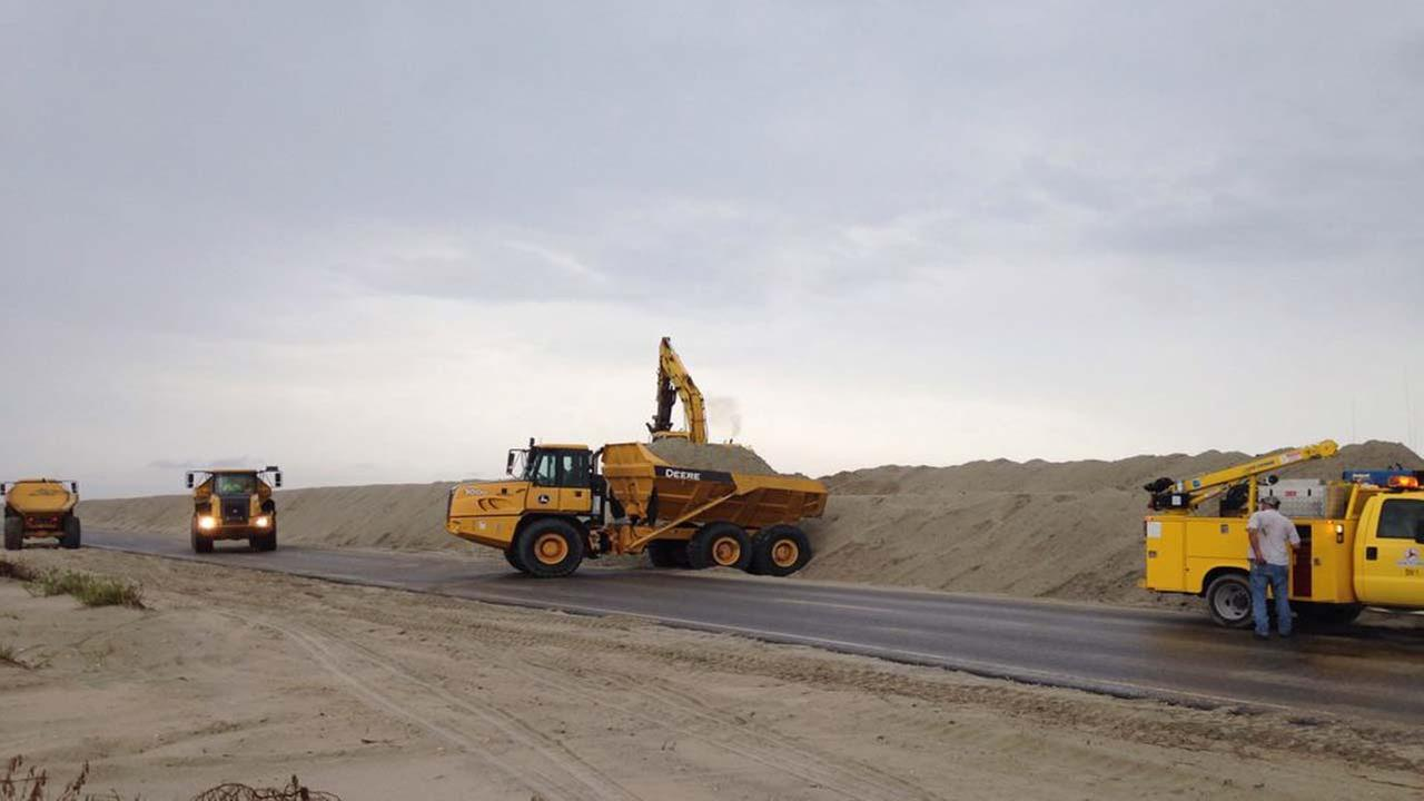 NCDOT crews at work on Ocracoke Island rebuilding the dunes damaged by Hurricane Arthur.