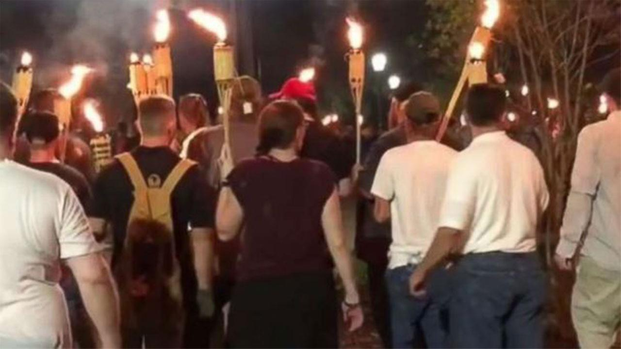 White nationalists holding tiki torches marched Friday night through the University of Virginia