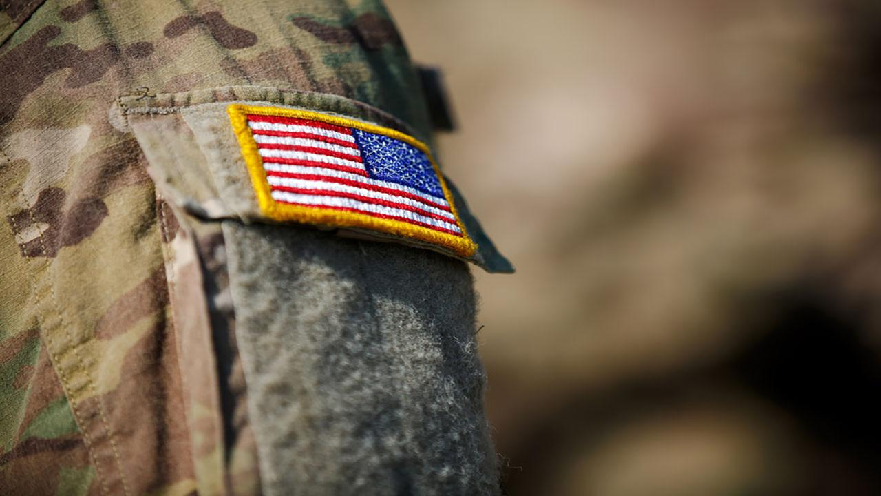 Soldier with flag on uniform