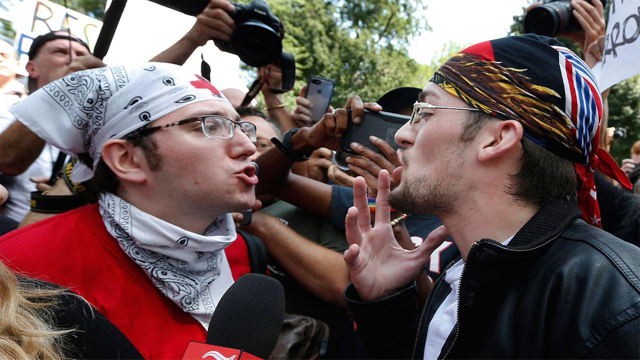 A counterprotester, left, confronts a professed supporter of President Donald Trump at a Free Speech rally by conservative activists on Boston Common, Saturday, Aug. 19, 2017