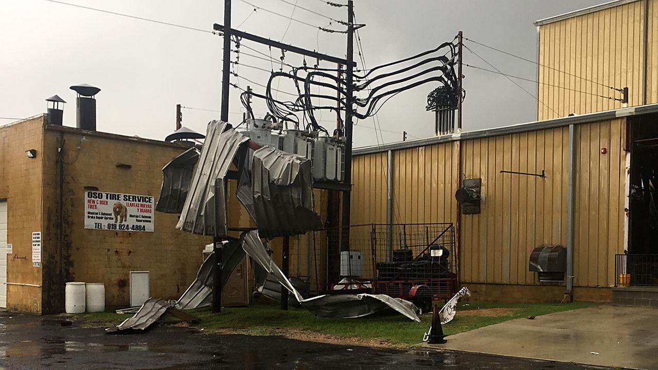 The roof was ripped off a business in Sanford and blown into some power lines Friday.Akilah Davis