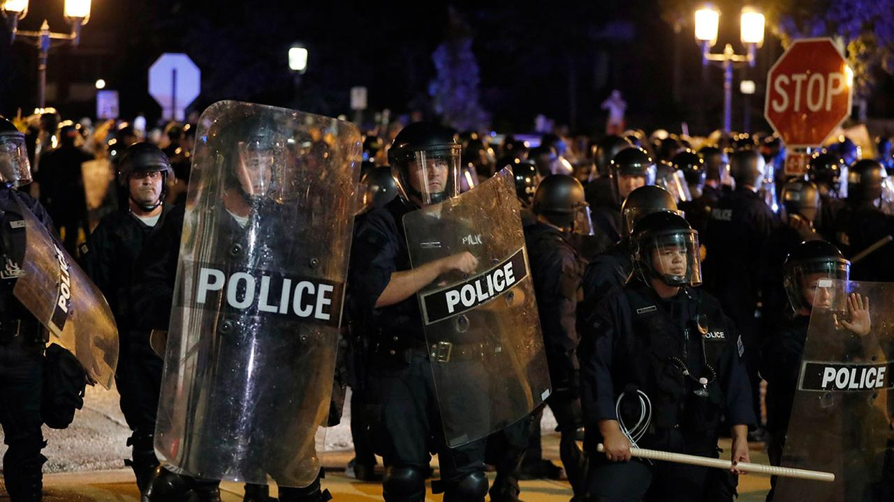 Police guard as protesters gather, Friday, Sept. 15, 2017, in St. Louis, after a judge found a white former St. Louis police officer, Jason Stockley, not guilty of first-degree murder in the death of a black man, Anthony Lamar Smith.