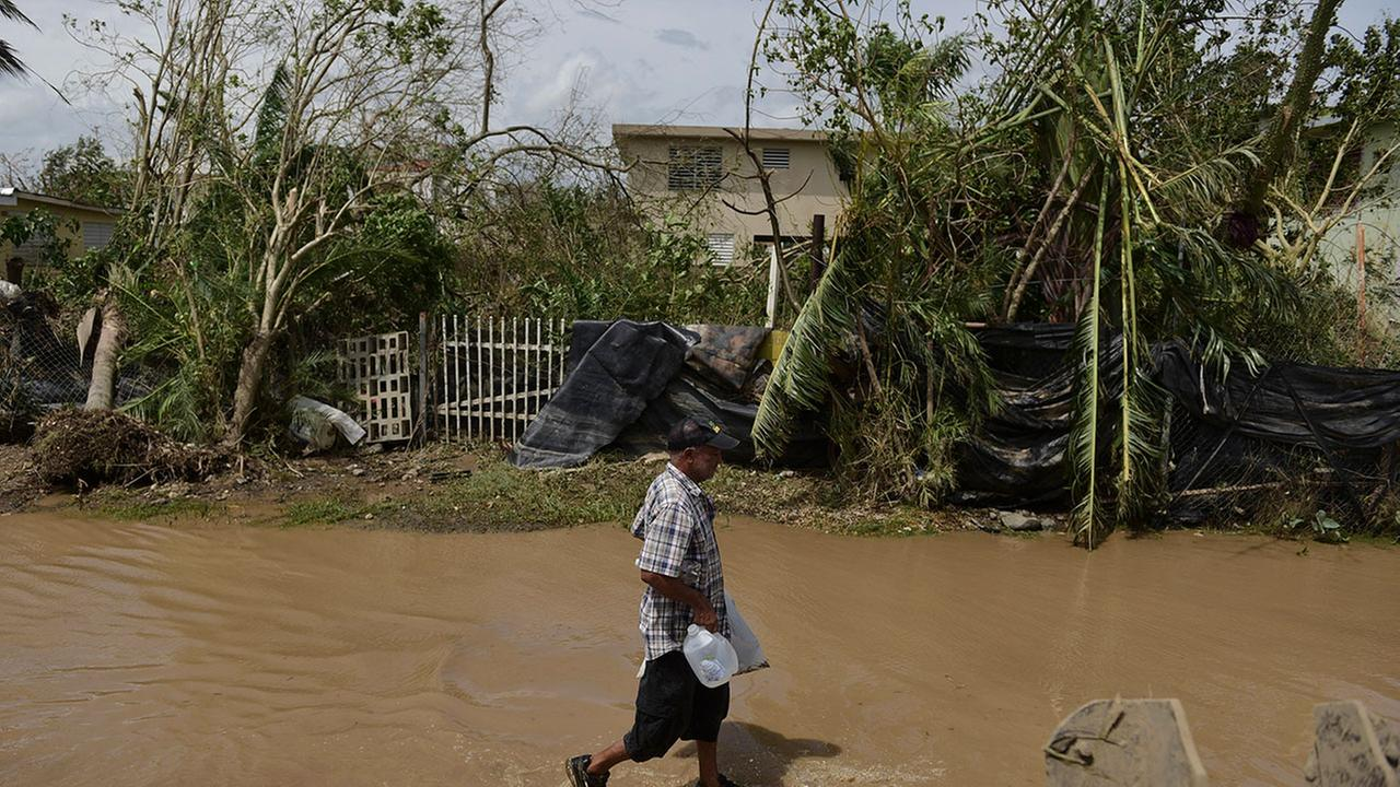 A resident walks on a flooded road after the passing of Hurricane Maria, in Toa Baja, Puerto Rico, Friday, September 22, 2017.
