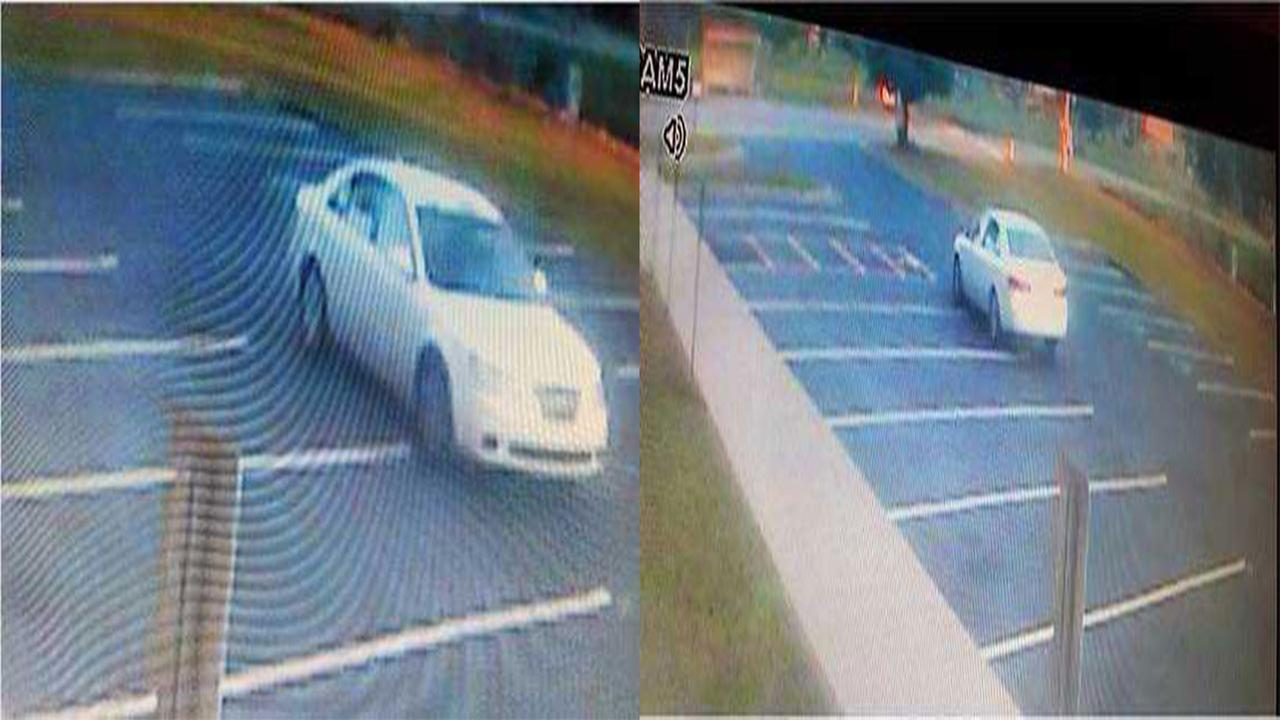 Suspects car: White 4-door sedan with tan interior.