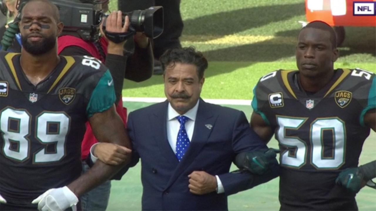 Jaguars Owner Shahid Khan also locked arms with his players on the sidelines