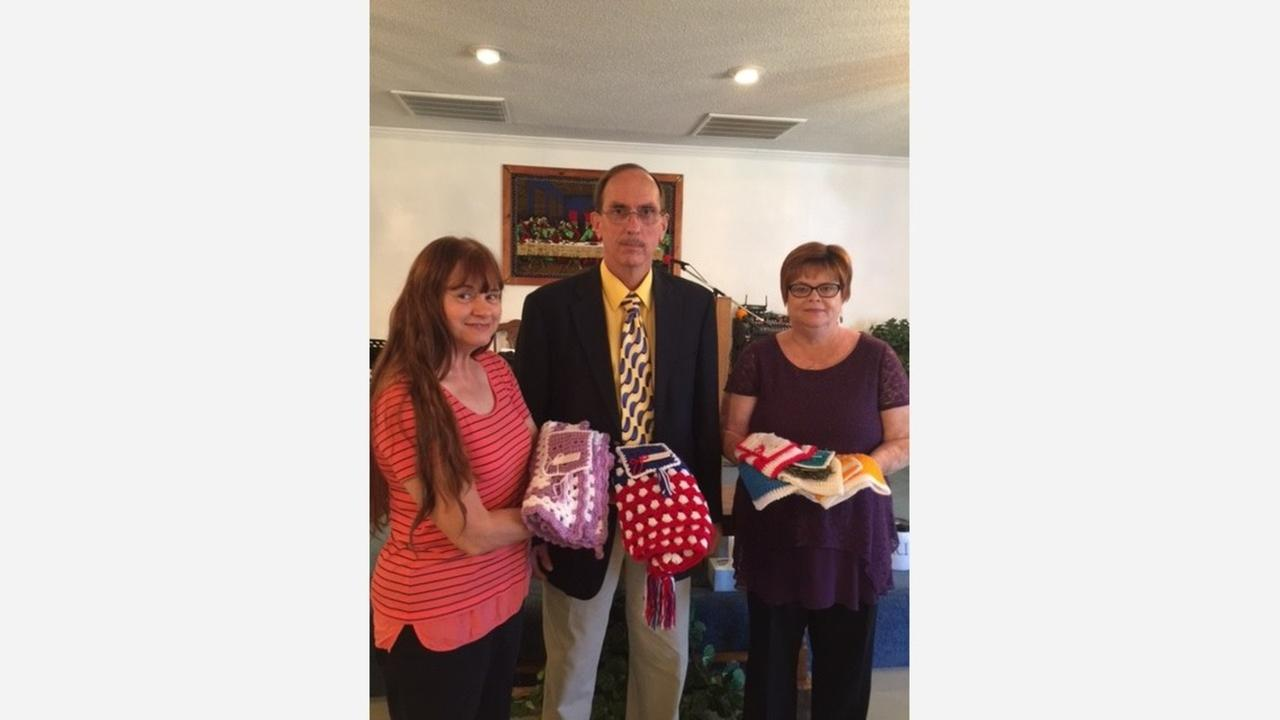 Louise Inscoe (left), Pastor Carroll Glasscock, and Ellen Campbell holding some of Ellens prayer cloths