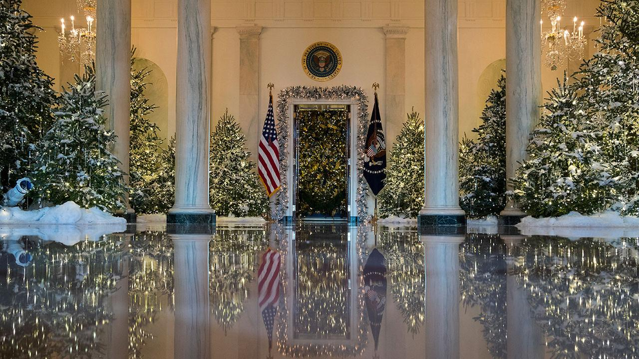 The Grand Foyer and Cross Hall are decorated with The Nutcracker Suite theme during a media preview of the 2017 holiday decorations at the White House
