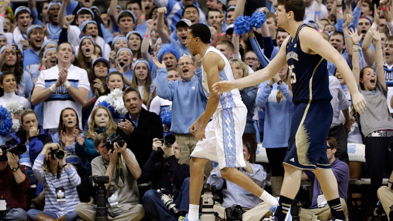 North Carolinas Brice Johnson reacts with the crowd as Notre Dames Tom Knight watches during the second half of an NCAA college basketball game in Chapel Hill on March 3, 2014.
