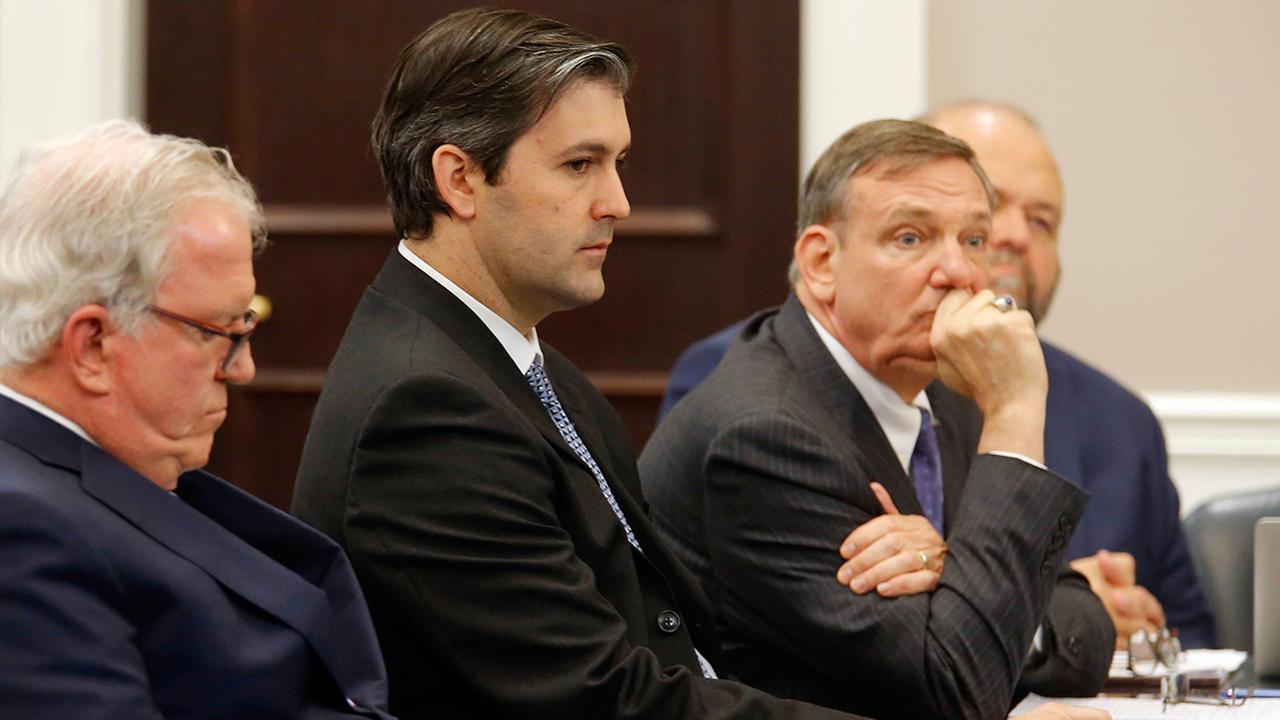 Defense attorneyssit around former North Charleston police officer Michael Slager at the Charleston County court in Charleston, S.C., Monday, Dec. 5, 2016.