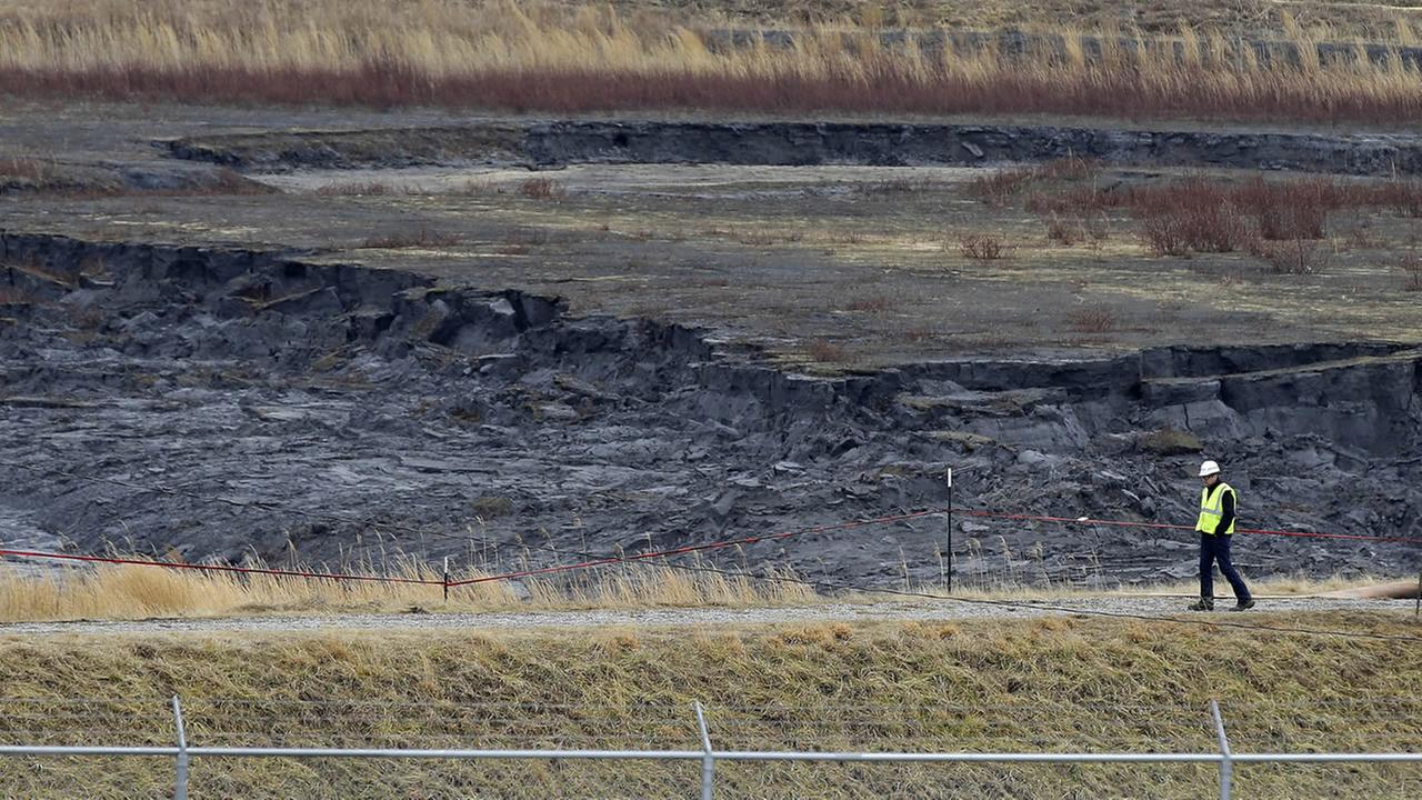 This Wednesday, Feb. 5, 2014 photo shows a coal ash pond at the Dan River Power Plant in Eden, N.C. (AP Photo/Gerry Broome)