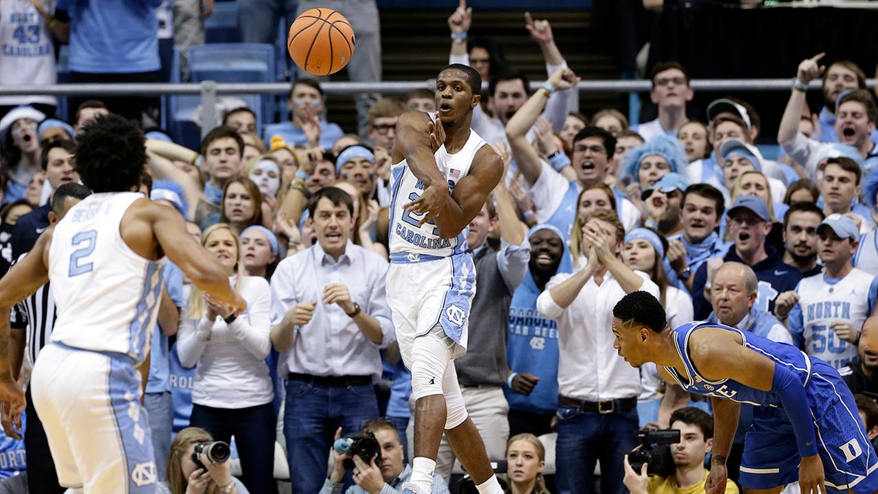 North Carolinas Kenny Williams saves the ball from going out of bounds as Dukes Gary Trent Jr. looks on.Gerry Broome